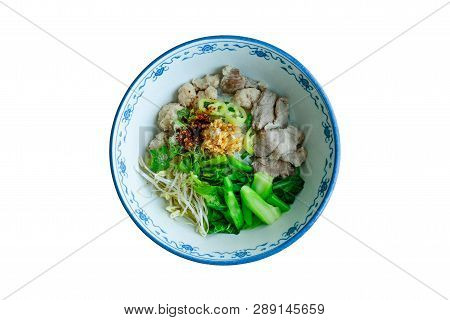Bowl Of Asian Noodles With Vegetables And Pak On Table Background