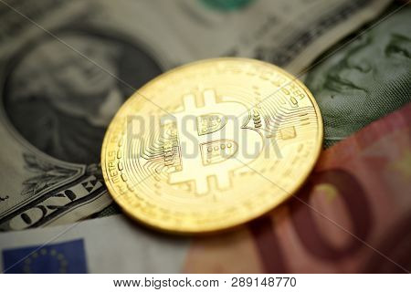 Bitcoins on a dollar banknotes.