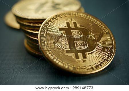 Bitcoins on a wood table.