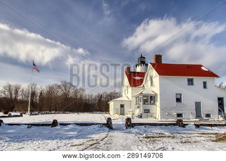 Winter Lighthouse Landscape. The Point Iroquois Lighthouse On The Shores Of Lake Superior Is A Feder