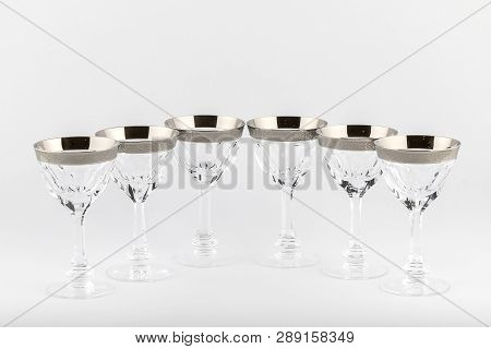 Stemware Faceted Glasses Made Of Czech Glass With A Silver Ornament Isolated On A White Background.