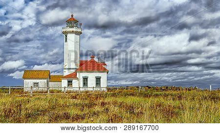 Port Townsend, Wa, Usa - September 23, 2018: The Point Wilson Lighthouse Is An Active Aid To Navigat