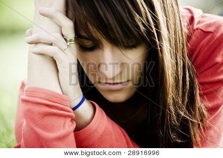 Young woman portrait showing sad gesture