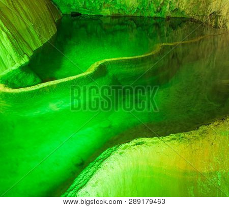 Cave Lake Nature Background. Amazing Cave Lake Nature Background. Artificial Green Lights In Cave. N