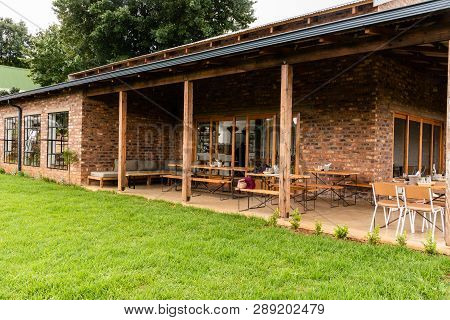 Natal Midlands, South Africa - March 11 2019: Outside Seating Area Of The Barn Owl Restaurant In The