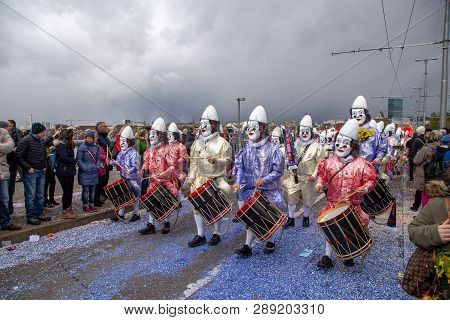 Basel, Switzerland - March 11, 2019: Participants At The Parade Of The Carnival Of Basel 2019. The C