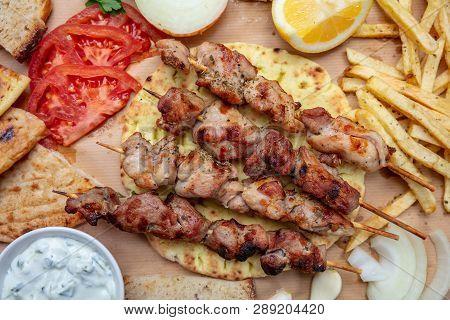 Souvlaki, Meat Skewers, Traditional Greek Turkish Meat Food On Pita Bread, Tzatziki Sauce And Potato