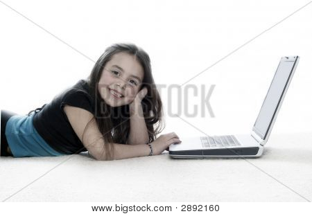 Young Girl Working On Laptop And Smiling At Camera