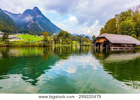 Königssee - the cleanest lake in Germany. Mountain Lake is a fabulous beauty in Bavaria. The lake is surrounded by high mountains. The concept of active, ecological and photo tourism