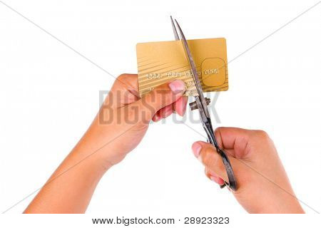 Cutting a gold credit card using a scissor, shot against very bright white background. Identification name has been removed and number has been scrambled.
