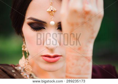 Mehndi Covers Hands Of Indian Woman, Henna Wedding Design, Woman Hands With Black Mehndi Tattoo. Han