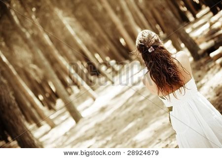 Young anonymous woman in the forest