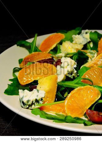 Super Nutritious Beautiful Fitness Salad. Restaurant Presentation. Arugula Salad With Grapes, Mandar