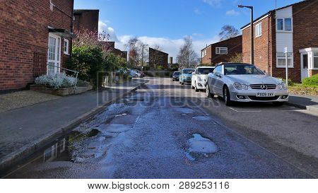 Harlow, England - 13 March 2019. A Potholes Road Leading Through A Housing Estate In The Staple Tye