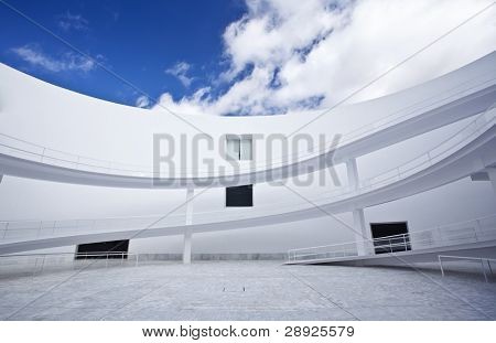 Abstract building exterior under blue sky