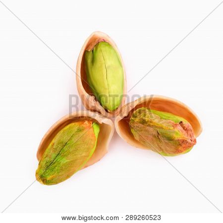 Pistachio Torn To Pieces With Whole Pistachio Isolated On White Background