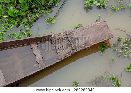Top View The Prow Of Wooden Boat As It Floats On Canal