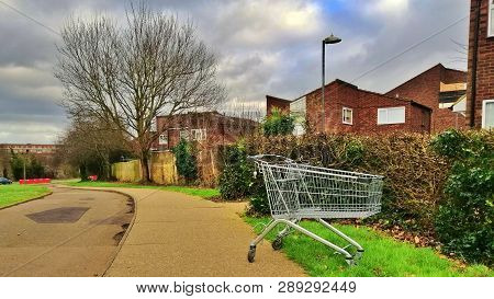 Harlow, England - March 13 2019. A Shopping Trolley Has Been Discarded At The Side Of The Path