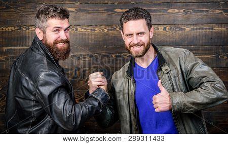 Friendship Of Brutal Guys. Handshake Symbol Of Successful Deal. Approved Business Deal. Handshake Ge