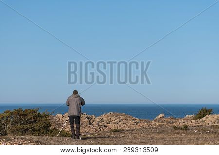 Bird Watcher By The Coast Of The Swedish Island Oland In The Baltic Sea