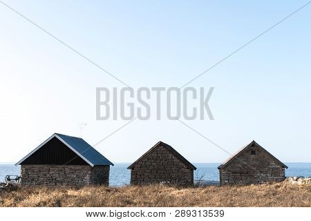 Traditional Fishing Cabins Built Of Limestone At The Swedish Island Oland In The Baltic Sea