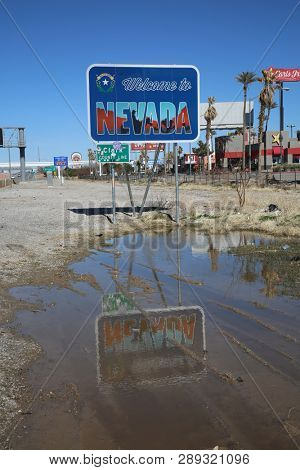 2-25-2019 Nevada, USA: Welcome to Nevada sign on the California - Nevada border. Nevada is home to Las Vegas and other cities that allow gambling and more.