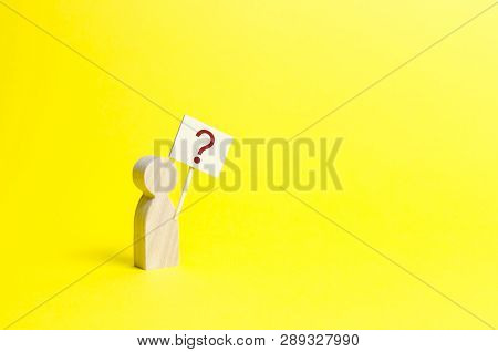 Wooden Human Figurine With A Question Mark. Minimalism. Asking A Question, Searching For Truth And D