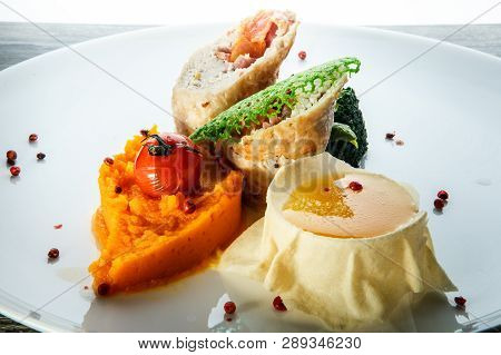 Macro Delicious Dissected Stuffed Chicken With Pumpkin Puree And Sauce