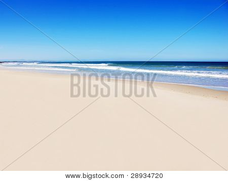 Open beach with blue water and sky