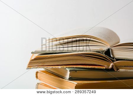 A Stack Of Old Books. Yellow Frayed Pages. Worn Damaged Book Covers. Book Store Or E-books.