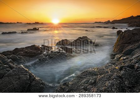 Romantic Sunset Over Rocky Coast And Soft Silky Water. Sardinia, Italy.