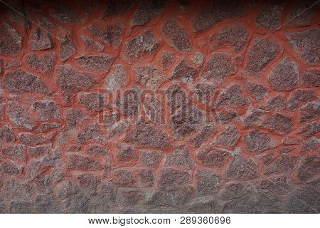 Red Brown Stone Cobble Stone Texture In A Fence Wall
