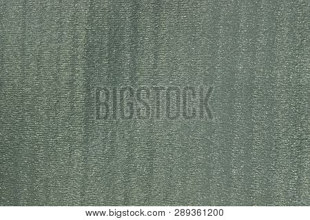 Gray Green Texture Of A Piece Of Plastic In The Wall