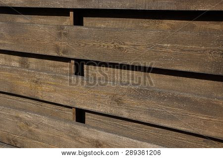 Brown Wooden Texture Of Dry Boards In The Wall Of The Fence