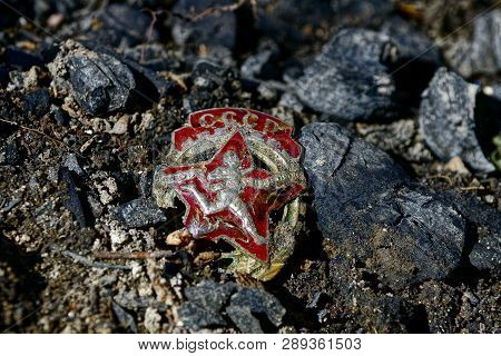 Old Soviet Badge Lies On The Ground In The Street