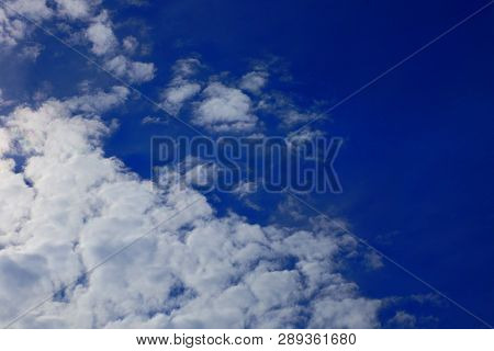 Many White Gray Beautiful Clouds On A Blue Day Sky