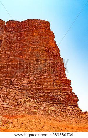 Dramatic Escarpment In The Desert In Wadi Rum In Jordan