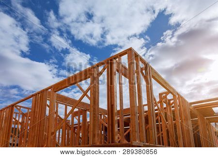 Close-up Of Beam Built Home Under Construction And Blue Sky With Wooden Truss, Post And Beam Framewo