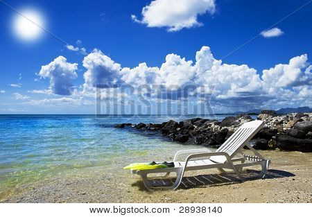 Lovely tropical island - beach chair on the beach and warm blue water
