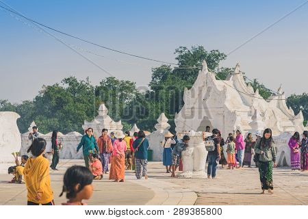 Mingun-myanmar, January 20, 2019 : Unidentified Tourists Make Merit, Pay Homage To Blessings At Mya
