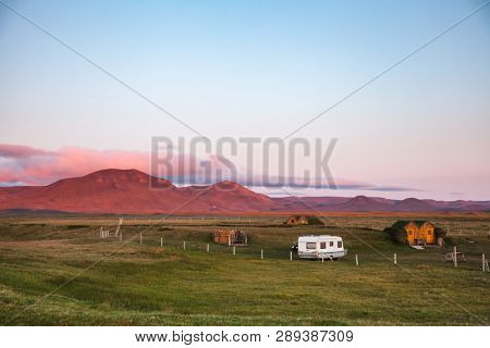 Camper trailer and turf roof wooden cabins at a campsite near Modrudalur farm, the highest inhabited settlement in Iceland, Nor?°ur-M??las??sla, Eastern Iceland, Scandinavia poster