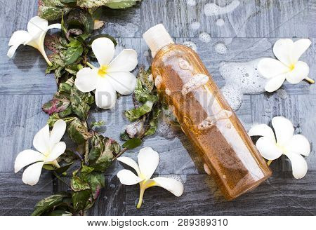 liquid soap exfoliating body wash smooth skin natural extract nature with soapsuds for health care body skin and flowers frangipani arrangement on tile poster