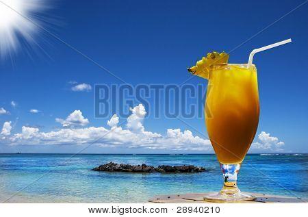 a Fresh fruit cocktail on a tropical island beach