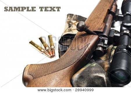 Close up of a rifle and bullets on a white background with space for text poster