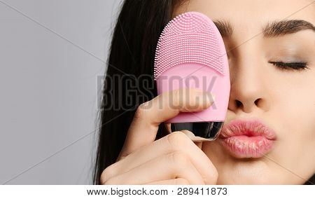 Young Woman With Pink Face Exfoliator Brush Silicone Cleansing Device For Sensitive Normal Skin Reli