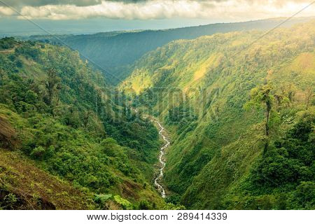 Scenic view of a ravine with a creek in central Costa Rica