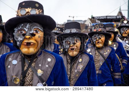 Basel, Switzerland - March 11, 2019: Participants At The Parade Of The Yearly Carnival Of Basel. The