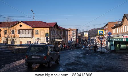SHEREGESH, RUSSIA - MAR 10, 2019: On one of the streets of Sheregesh urban-type settlement in Mountain Shoria. It is now one of the most popular winter sports resort where more than million of tourist