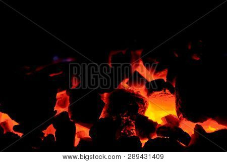 Coal Anthracite. Burning Coal In The Furnace Of A Solid Fuel Boiler. Heat. Flame. Forge Furnace. Hot