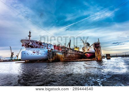 Two large ships in dry repair dock
